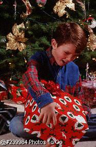 Boy w/present near Christmas tree